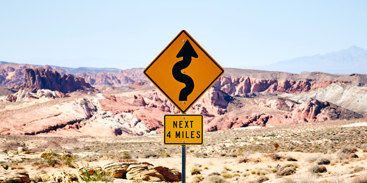 A photo of road signage with a dramatic background