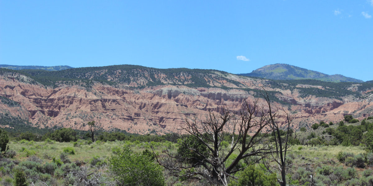 Red sandy cliffs and mountain views near the campground