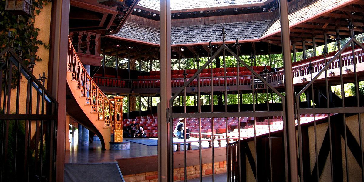 A view of the stage and seating inside the mini Globe Theatre