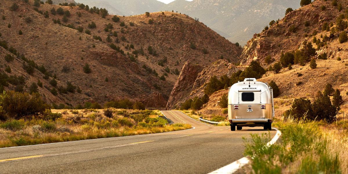 An RV driving in the desert
