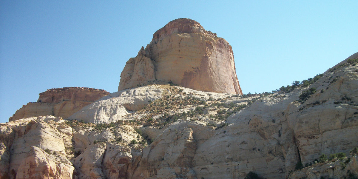 A large sandstone monolith rises from the surrounding rocks
