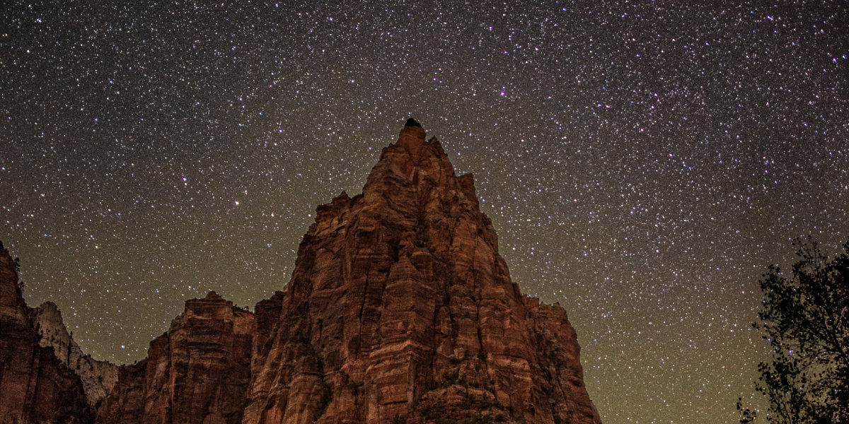 Cliffs in Southern Utah with stars shining in the night sky.