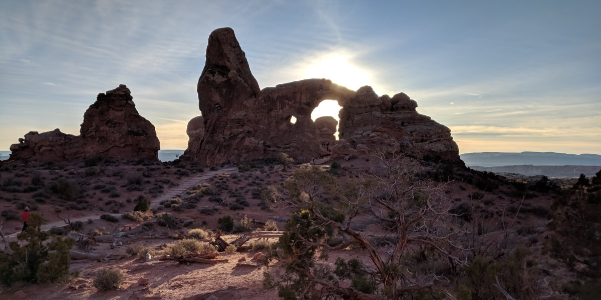 A large impressive arch with sandstone monolith