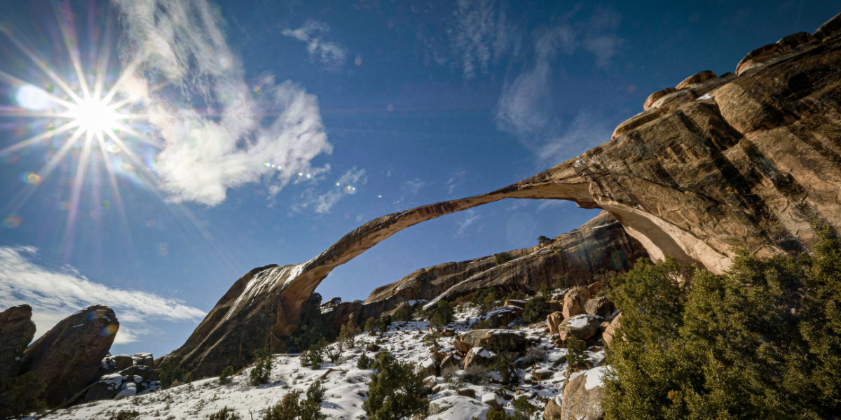 A thin long arch with snow and sunshine