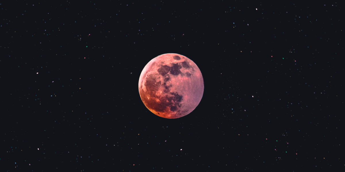The full moon with a reddish tint