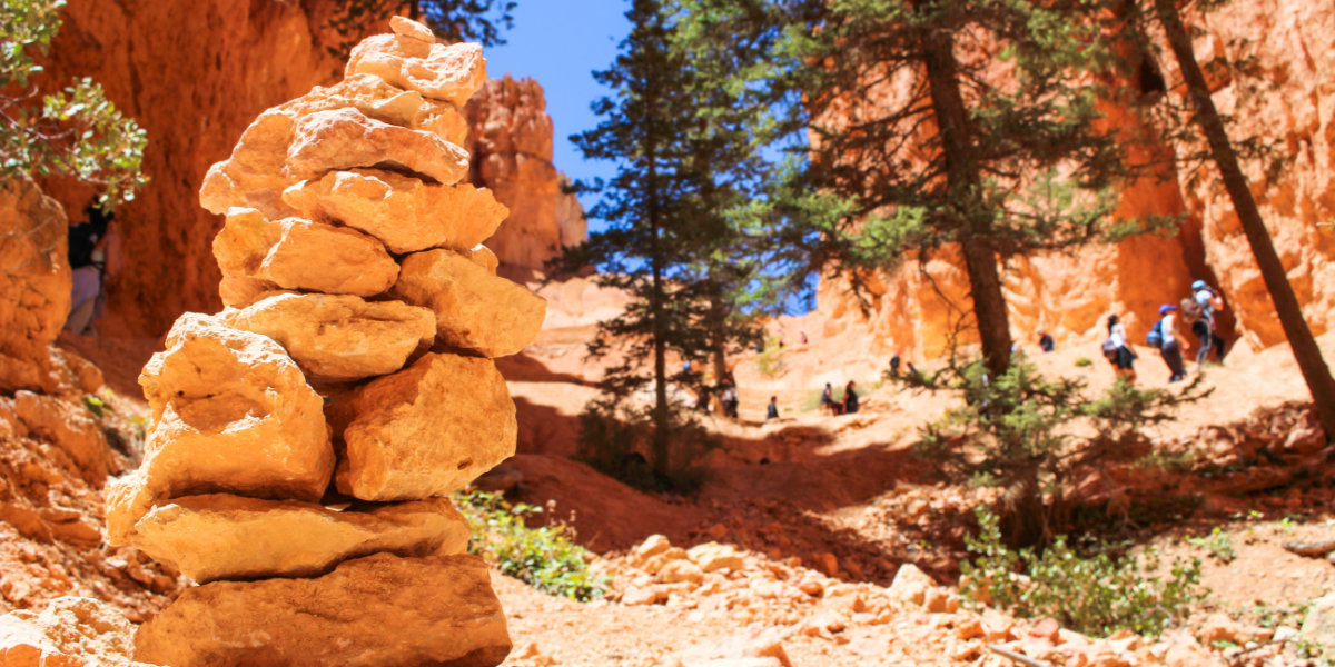 Hikers walking among the hoodoos