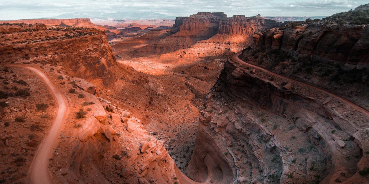The dramatic switchbacks of the White Rim Road as seen at sunset