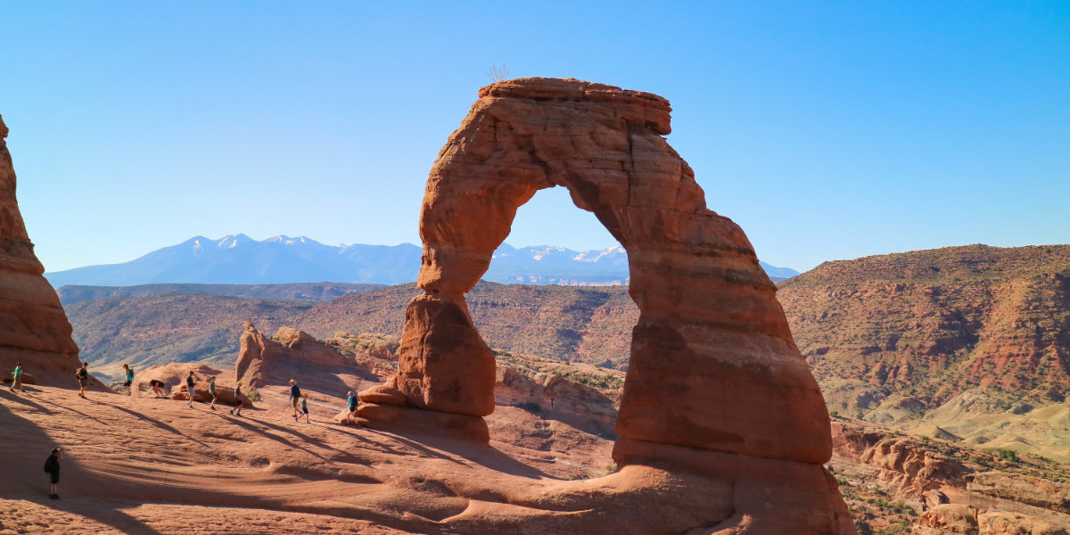 The famous Delicate Arch, a sandstone arch with blue sky background