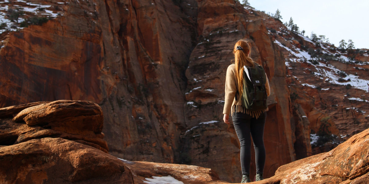A woman hikes in Zion National Park