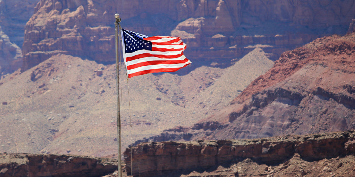 American Flag in front of red rock background