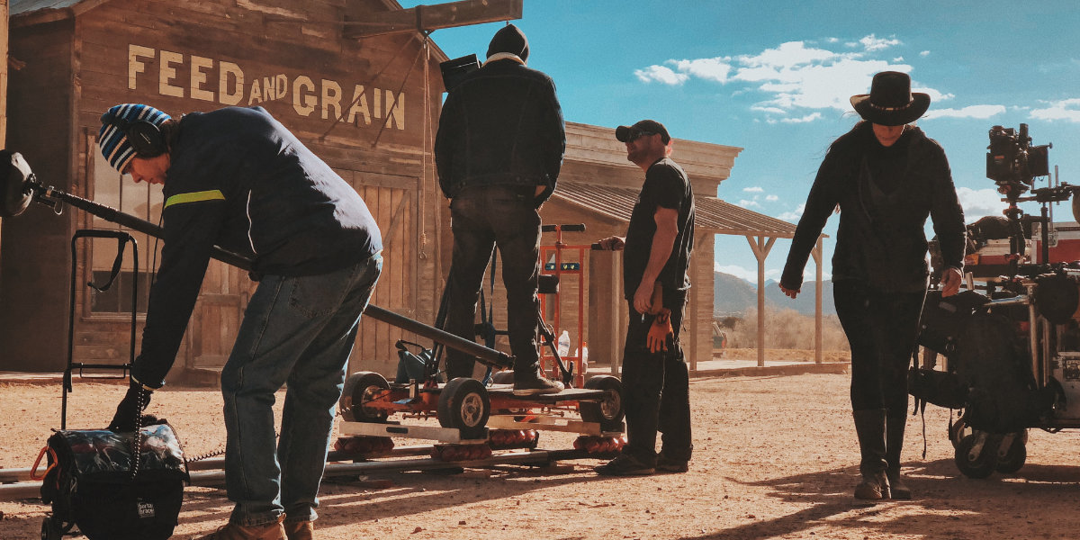 A film production on a set in the desert