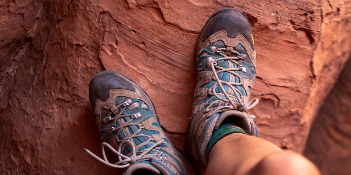 Hiking boots on red sandstone