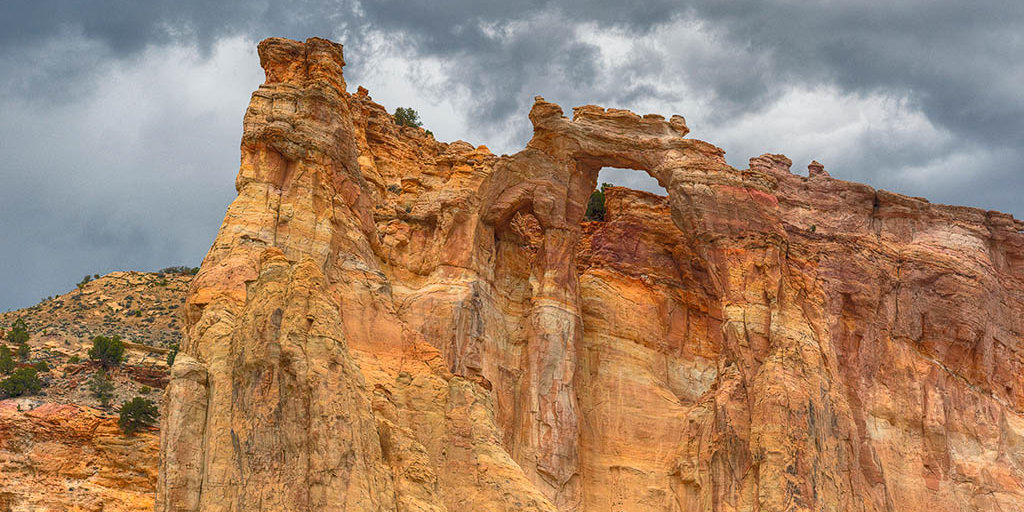 A double arch high in the sandstone cliff