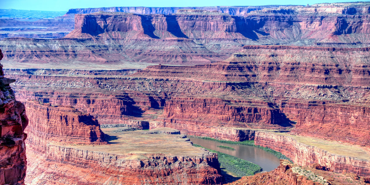 An overlook of a wide canyon river