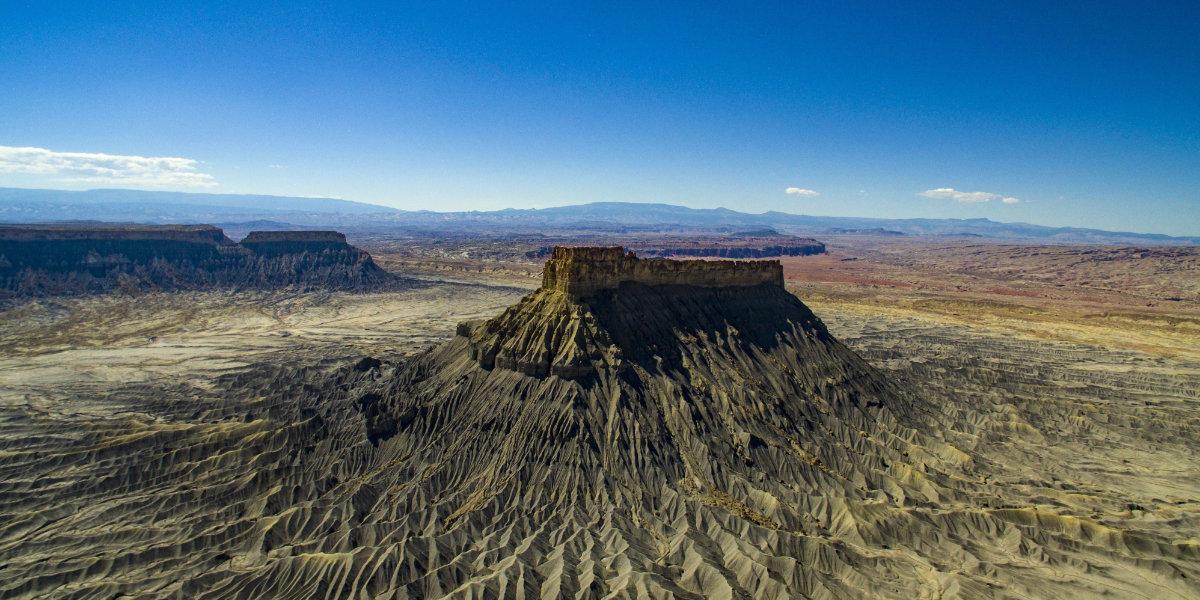 Gray desert dunes and Factory Butte